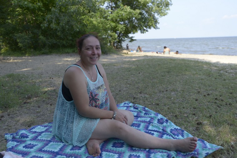 """Erica Coleman, who lives in Dundalk, enjoys the variety of people who come to North Point State Park. """"It's a mixed crowd --there's a mixture of people like all different nationalities,"""" she said. """"Everyone's been friendly."""" (Christina Tkacik/Baltimore Sun)"""