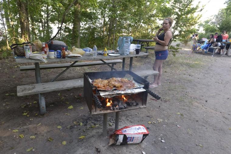 People enjoy grilling at North Point State Park. (Christina Tkacik/Baltimore Sun)