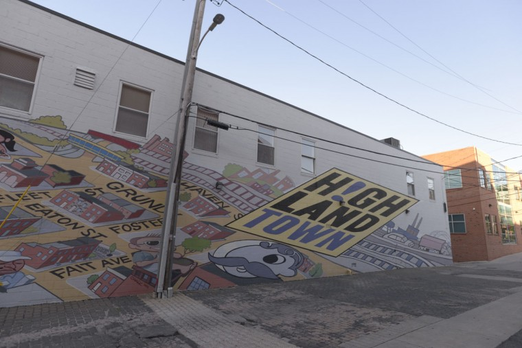 A mural on the south side of Eastern Avenue -- technically just below the neighborhood's border, but no matter -- depicts the history of the neighborhood. (Christina Tkacik/Baltimore Sun)