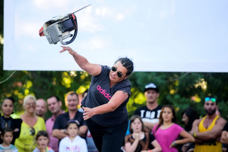 A woman competes in the 4th Chainsaw Throw Championship in Kocevje, on July 1, 2017. (JURE MAKOVEC/AFP/Getty Images)