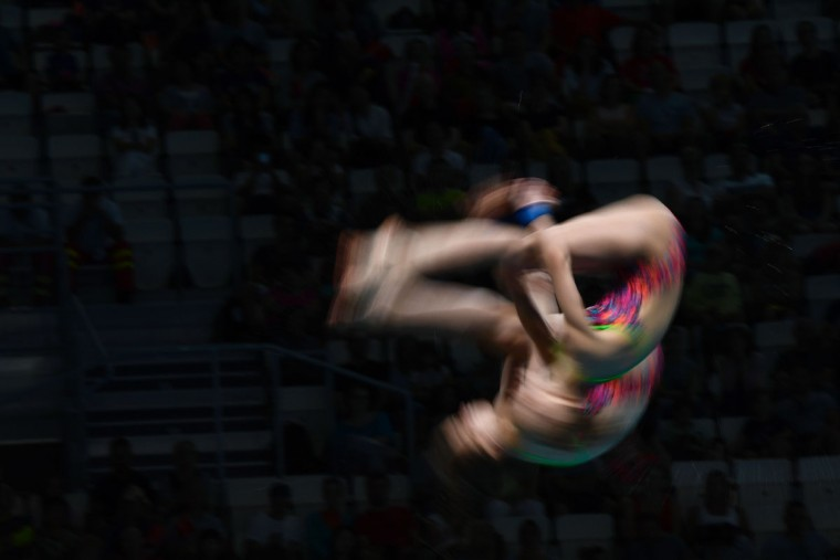 Russia's Valeriia Belova and Russia's Iuliia Timoshinina compete in the women's 10m platform synchro final during the diving competition at the 2017 FINA World Championships in Budapest, on July 16, 2017. / (AFP Photo/Christophe Simon)