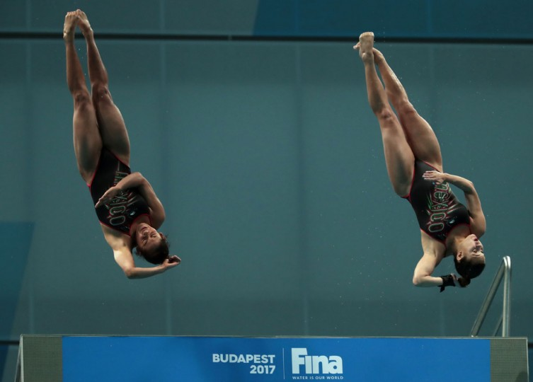 Mexico's Gabriela Agundez Garcia and Mexico's Samantha Jimenez Santos compete in the women's 10m platform synchro final during the diving competition at the 2017 FINA World Championships in Budapest, on July 16, 2017. / (AFP Photo/Ferenc Isza)