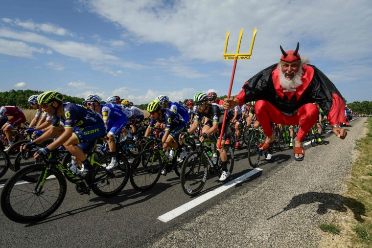 German supporter Didi Senft known as El Diablo jumps as the pack ride during the 213,5 km seventh stage of the 104th edition of the Tour de France cycling race on July 7, 2017 between Troyes and Nuits-Saint-Georges. (Philippe Lopez/AFP/Getty Images)