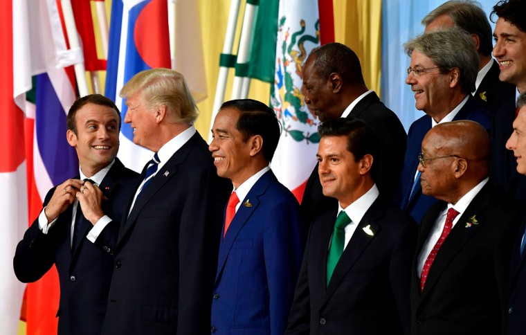 (1st row L-R) French President Emmanuel Macron, US President Donald Trump, Indonesia's President Joko Widodo, Mexico's President Enrique Pena Nieto, South Africa's President Jacob Zuma pose for a family photo of the participants of the G20 summit in Hamburg, northern Germany on July 7, 2017.Leaders of the world's top economies gather from July 7 to 8, 2017 in Germany for likely the stormiest G20 summit in years, with disagreements ranging from wars to climate change and global trade. / (AFP Photo/Tobias Schwarz)