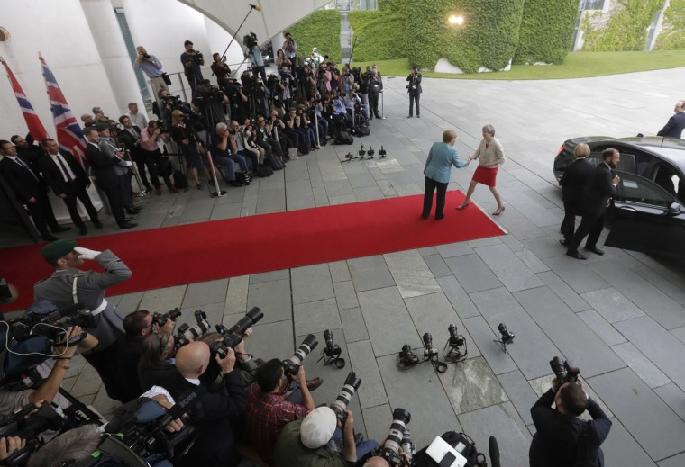 British Prime Minister Theresa May, right, is welcomed by German Chancellor Angela Merkel prior to a gathering of European leaders on the upcoming G-20 summit in the chancellery in Berlin, Germany, Thursday, June 29, 2017. (AP Photo/Markus Schreiber)