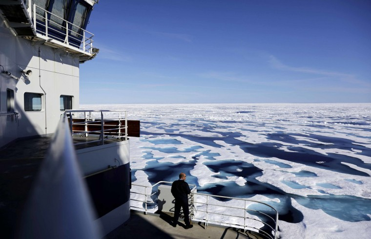 In this Saturday, July 22, 2017 photo, Canadian Coast Guard Capt. Victor Gronmyr looks out over the ice covering the Victoria Strait as the Finnish icebreaker MSV Nordica traverses the Northwest Passage through the Canadian Arctic Archipelago. (AP Photo/David Goldman)