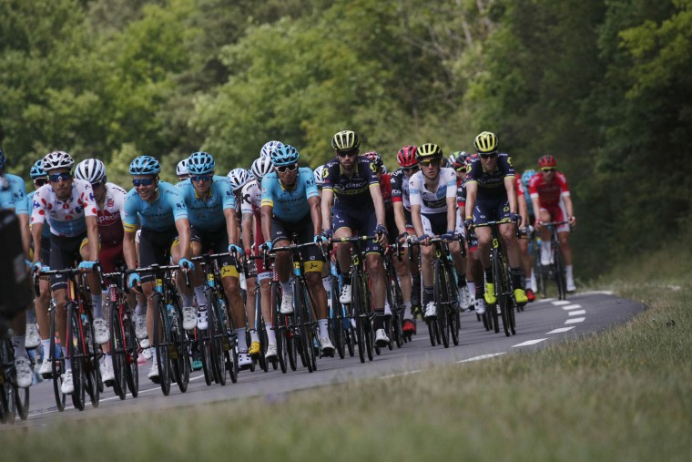 Italy's Fabio Aru, wearing the best climber's dotted jersey, far left, rides in the pack with his Astana teammates during the seventh stage of the Tour de France cycling race over 213.5 kilometers (132.7 miles) with start in Troyes and finish in Nuits-Saint-Georges, France, Friday, July 7, 2017. (AP Photo/Christophe Ena)