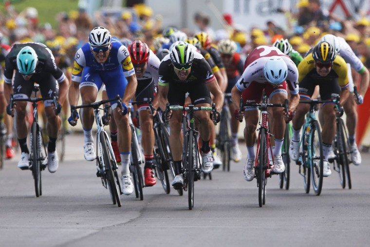 Germany's sprinter Marcel Kittel, second left, sprints to the finish line ahead of Norway's Edvald Boasson Hagen, center and second place, and Norway's Alexander Kristoff , second right, to win the seventh stage of the Tour de France cycling race over 213.5 kilometers (132.7 miles) with start in Troyes and finish in Nuits-Saint-Georges, France, Friday, July 7, 2017. (AP Photo/Peter Dejong)