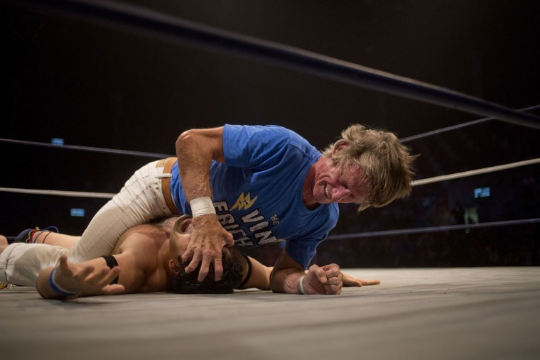 Wrestler Kevin Von Erich fights with Jumping Lee during The Rage Wrestling Mega Show in Tel Aviv, Israel, Sunday, July 9, 2017. The Israeli Wrestling League hosted a wrestling show in Tel Aviv with some of the WWE greatest of all time. (AP Photo/Ariel Schalit)