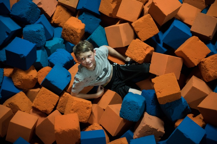 Aaron McVey, 12, looks up to his friends after jumping into the foam pit at the Charm City Skatepark in Baltimore on Thursday, July 6, 2017. (Michael Ares / The Baltimore Sun)