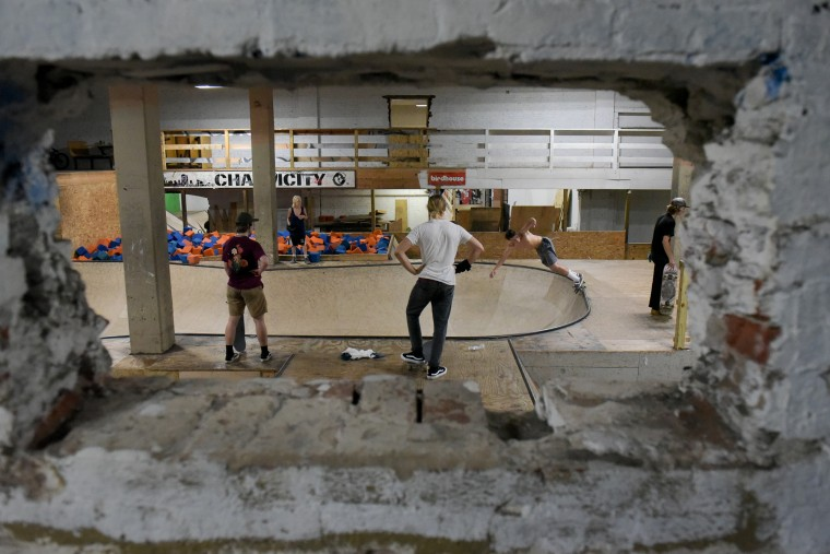 Skateboarders practice inside the Charm City Skatepark in Baltimore on Thursday, July 6, 2017. (Michael Ares / The Baltimore Sun)