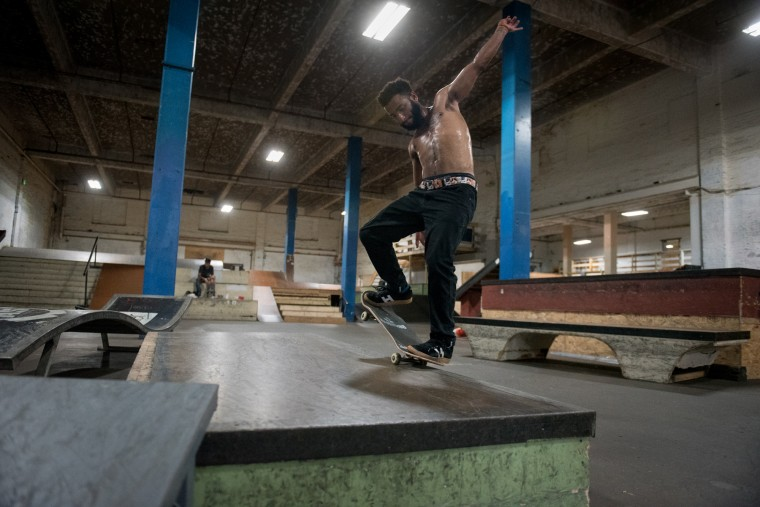 Austin Copeland performs a nose manual trick inside the Charm City Skatepark in Baltimore on Thursday, July 6, 2017. (Michael Ares / The Baltimore Sun)