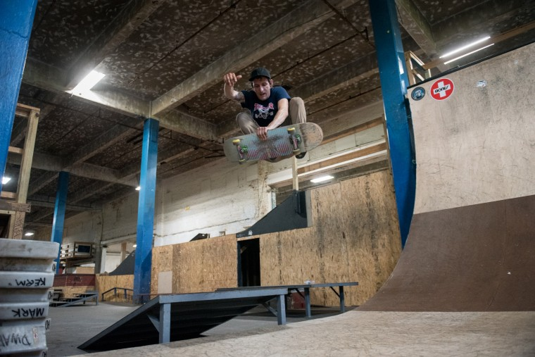 Chris Lannantuono, 26, of Baltimore, does a 180 Boneless trick inside the Charm City Skatepark in Baltimore on Friday, July 7, 2017. (Michael Ares / The Baltimore Sun)