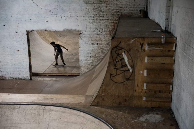 Chris Lannantuono, 26, of Baltimore, rides his skateboard inside the Charm City Skatepark in Baltimore on Friday, July 7, 2017. (Michael Ares / The Baltimore Sun)