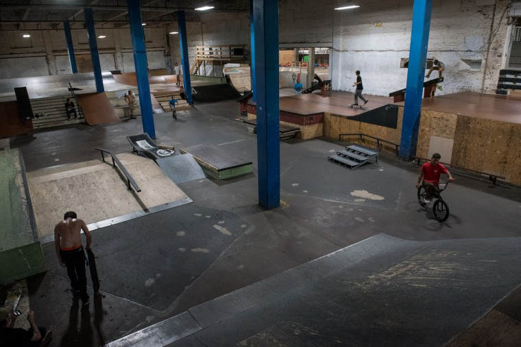 Skateboarders practice inside the Charm City Skatepark in Baltimore on Friday, July 7, 2017. (Michael Ares / The Baltimore Sun)
