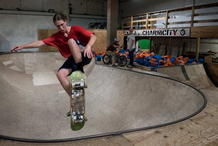 Jordan Oliver, 17, of Baltimore, rides the skateboard rink inside the Charm City Skatepark in Baltimore on Friday, July 7, 2017. (Michael Ares / The Baltimore Sun)