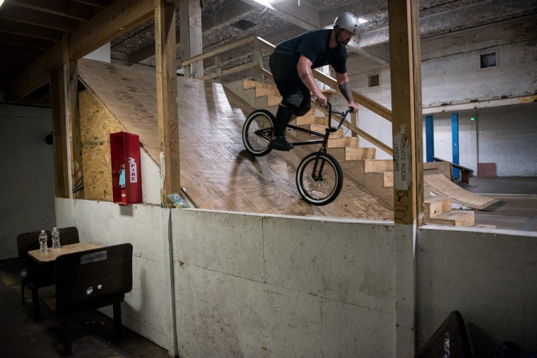 Dan Reinhardt, 33, of Frederick, rides his bike inside the Charm City Skatepark in Baltimore on Friday, July 7, 2017. (Michael Ares / The Baltimore Sun)