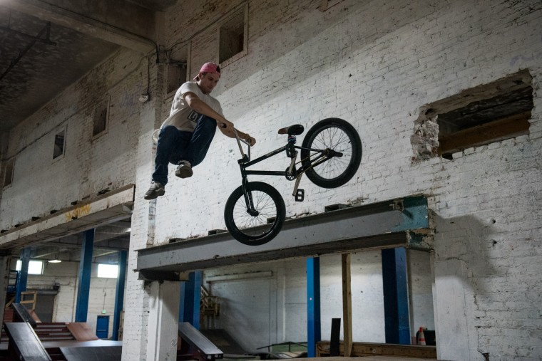 Steven Jefferies, a 20-year-old visiting from Fort Walton Beach, Fla., rides his bike inside the Charm City Skatepark in Baltimore on Friday, July 7, 2017. (Michael Ares / The Baltimore Sun)