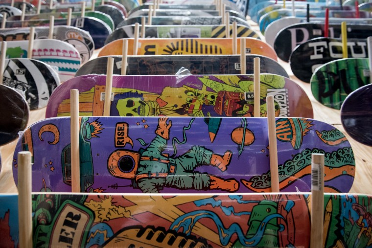 Skateboards stylized in many unique types of art fill the racks at the front office inside the Charm City Skatepark in Baltimore. (Michael Ares / The Baltimore Sun)