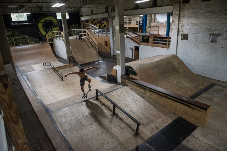 Ian Merrell, 19, rides his skateboard inside the Charm City Skatepark in Baltimore on Thursday, July 6, 2017. (Michael Ares / The Baltimore Sun)