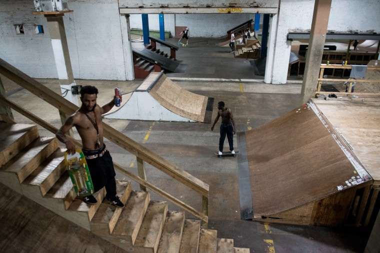 Austin Copeland, left, makes his way down to the floor as Matthew Summers, right, rides down the ramp inside the Charm City Skatepark in Baltimore on Thursday, July 6, 2017. (Michael Ares / The Baltimore Sun)