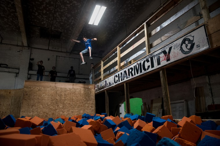 Toby Jones, a 14-year-old visiting from Ann Arbor, Mich., jumps into the foam pit at the Charm City Skatepark in Baltimore on Thursday, July 6, 2017. (Michael Ares / The Baltimore Sun)