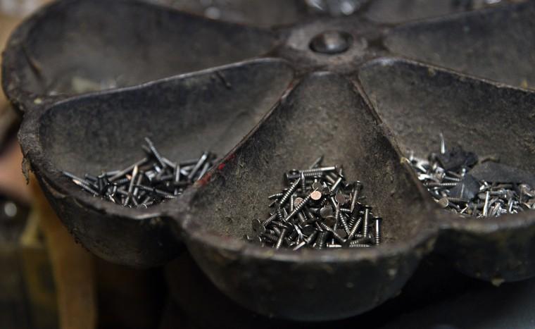 Shoe nails are in a metal dish at ESG Shoe Repair. (Barbara Haddock Taylor/ Baltimore Sun)