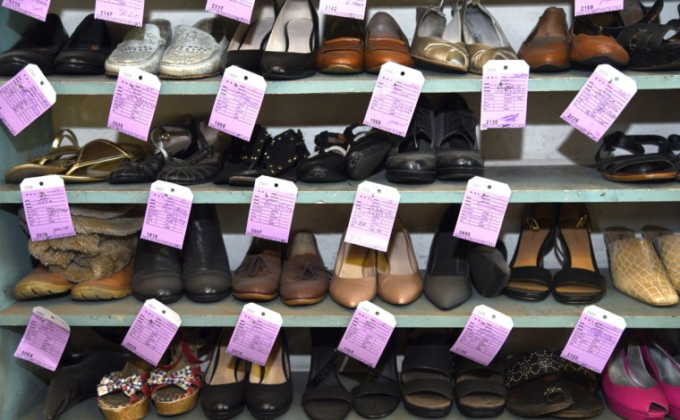 Repaired shoes await customer pickup at ESG Shoe Repair. (Barbara Haddock Taylor/ Baltimore Sun)
