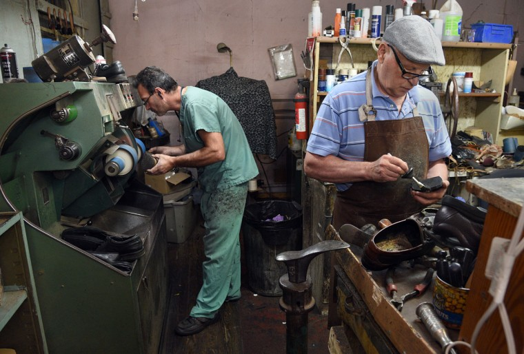 Eugene Gomberg, left, and helper Leonid Boryachinsky, right, work on shoes in the shop. Mr. Gomberg is owner of ESG Shoe Repair in Roland Park. and has been a cobbler for 25 years. Mr. Boryachinsky, a friend, helps out when things get busy. (Barbara Haddock Taylor/ Baltimore Sun)