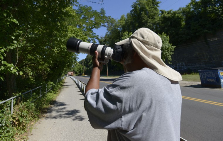George Washington Williams uses a strong telephoto lens to observe and document the lives of the yellow-crowned night heron. HE tracks their movements in a spreadsheet that he keeps in his pocket. (Christina Tkacik/Baltimore Sun)
