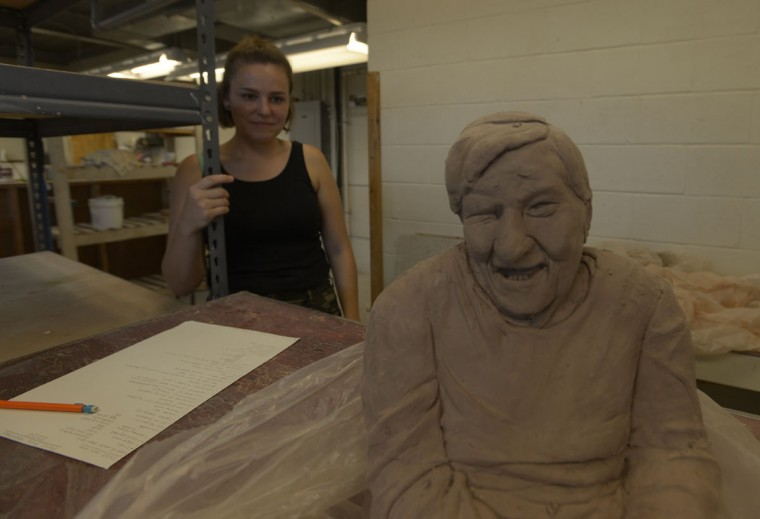 Resident Emily Irvin with a sculpture of her late grandmother, whom she helped care for. Irvin said she plans to toss the sculpture -- which she spent weeks working on -- since she will not be able to fire it in the Clayworks kiln. (Christina Tkacik/Baltimore Sun)