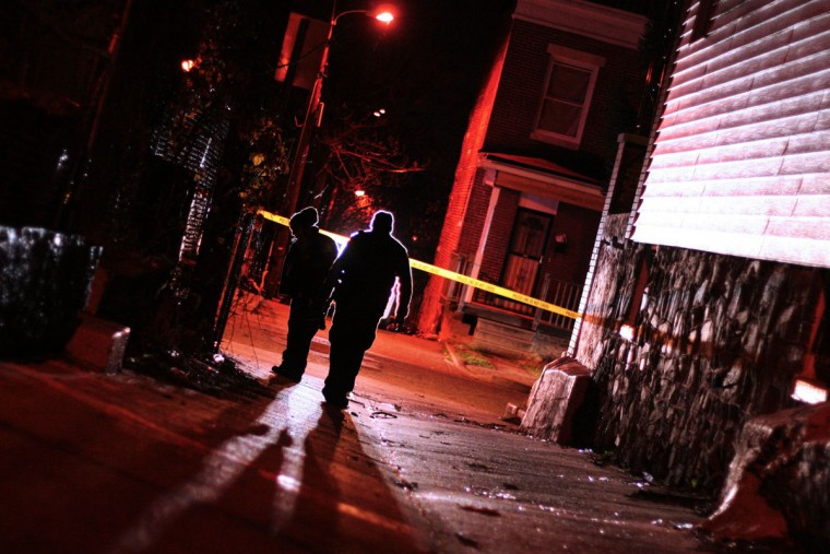 """Police investigate a December 2014 shooting in the 500 block of Edgewood Street."" (Photo and caption courtesy of Maggie Ybarra)"