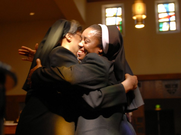 "CATONSVILLE, MD -- 3/25/09 -- MD OBLATES C KAWAJIRI -- Sister Mary Annette Beecham, Superior General of Oblate Sisters of Providence (LT), gives Sister Mary Anthonia Nwoga, a Nigerian-born woman in her 40s (RT) a hug after the ""Presentation of the Veil"". Liturgy of the Eucharist and Rite of First Profession for Sister Anthonia Nwoga was held at the Oblate Sisters of Providence. This is a big deal for an order that has seen its numbers decline steadily for years as nuns die off and aren't replenished with new arrivals. The Oblate Sisters of Providence was founded in Baltimore in 1829 and is the first Roman Catholic religious order made up entirely of African American women. The taking of the black veil means Anthonia will go from ""novice"" to ""professed sister,"" and she'll then have five years to decide whether to make her ""final vows."" The point is this is a big step toward becoming a lifelong member of the order. (CHIAKI KAWAJIRI/ Baltimore Examiner and Washington Examiner)"