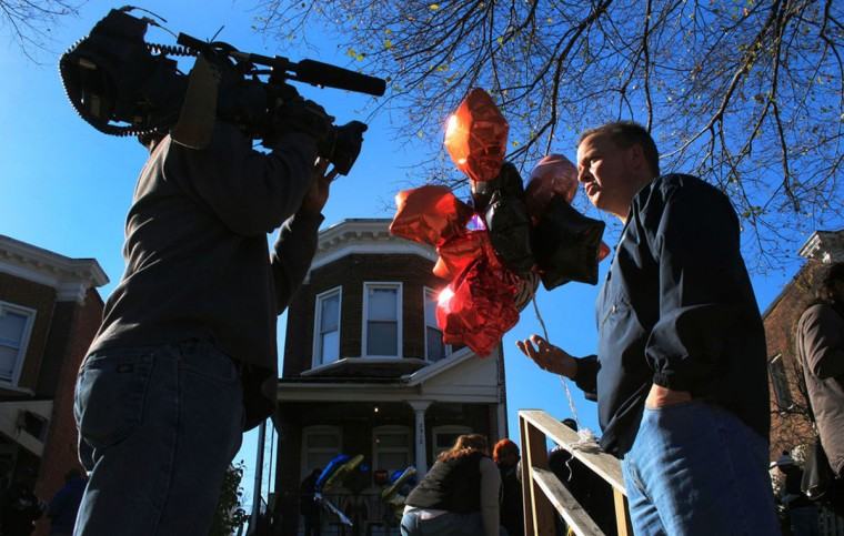 """Baltimore Police Commissioner Kevin Davis talks to local media about why it was important for police to pitch in and finish building Kendal Fenwick's fence. Police and the community gathered at Fenwick's house on November 15, 2015, a few days after Fenwick was murdered."" (Photo and caption courtesy of Maggie Ybarra)"