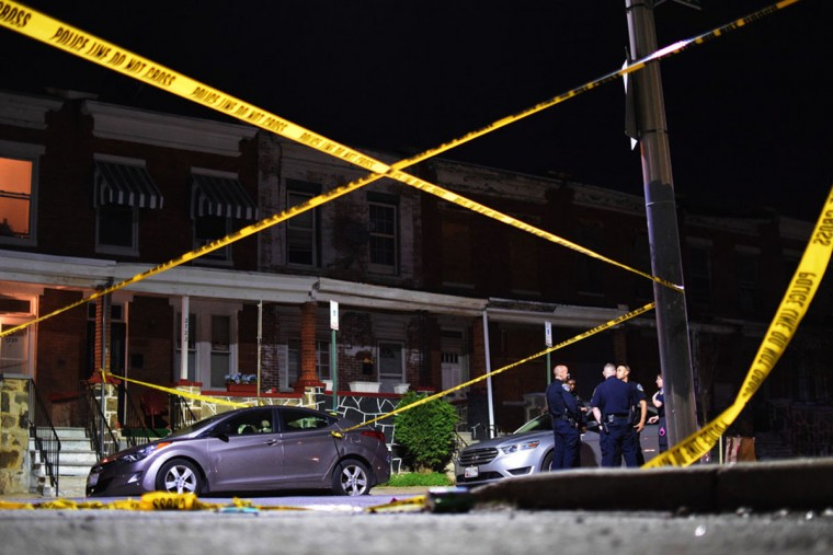 """Police tape frames a police investigation into an April 2017 shooting in the 2700 block of Ashland Avenue."" (Photo and caption courtesy of Maggie Ybarra)"