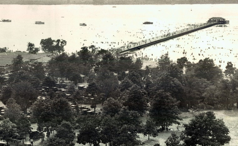 An aerial view of Fort Smallwood Park in the summer of 1930 shows the pier, the bath houses, bathers and boaters.  (Baltimore Sun)