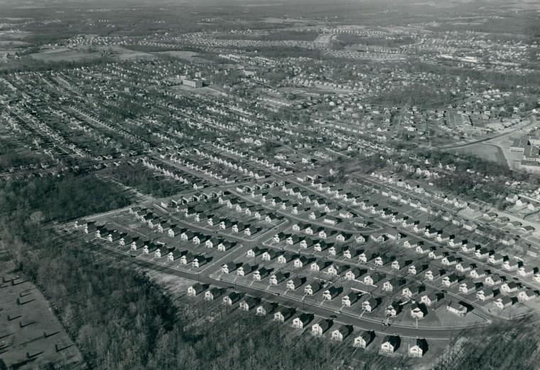 Single family homes are seen on Garnett Road (foreground) in Parkville in 1956. (Richard Stacks/Baltimore Sun)