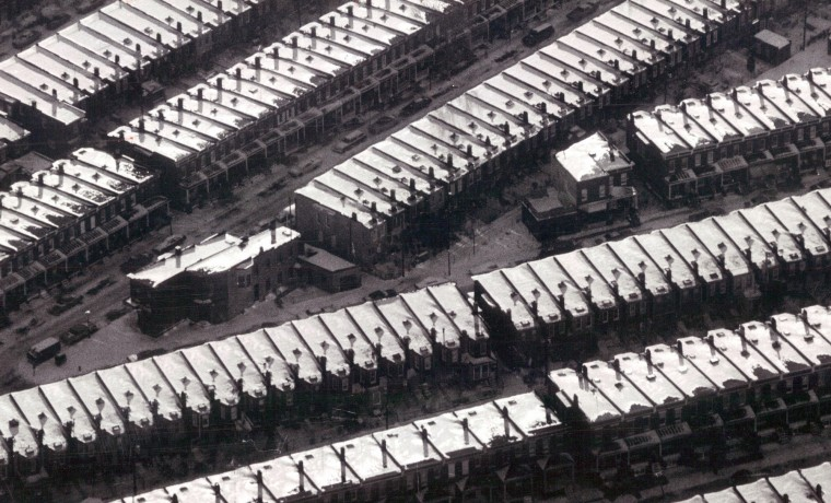 Snow on rooftops in East Baltimore reflects the light in 1973.   (Richard Childress/Baltimore Sun)