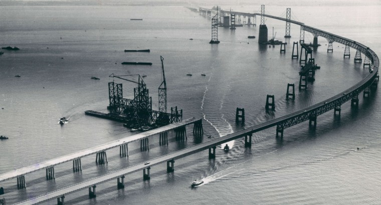 The parallel bay bridge keeps stretching further out into the Chesapeake Bay as this 1971 aerial photo shows. The view, taken from the western shore, includes the present bridge which can been seen to the right of the new span.  (William L. LaForce, Jr./Baltimore Sun)