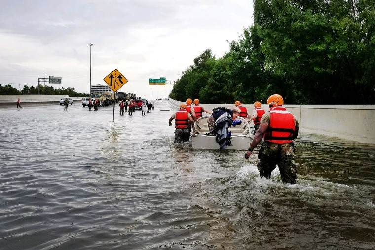 HOUSTON, TX - AUGUST 27: In this handout provided by the Army National Guard, Texas National Guardsmen rescue a resident by boat during flooding caused by Hurricane HarveyAugust 27, 2017 in Houston, Texas. Harvey, which made landfall north of Corpus Christi late Friday evening, is expected to dump upwards to 40 inches of rain in areas of Texas over the next couple of days. (Photo by Lt. Zachary West/Army National Guard via Getty Images)