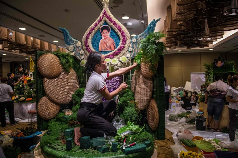 A Thai woman puts together the background to a decoration that will include different vegetable and fruit decorations during a fruit and vegetable carving competition in Bangkok on August 4, 2017. It is a royal tradition that has proved bountiful through the ages and one that Thailand's fruit carvers are determined to keep alive -- even as young people peel away from the unique art form. (ROBERTO SCHMIDT/AFP/Getty Images)