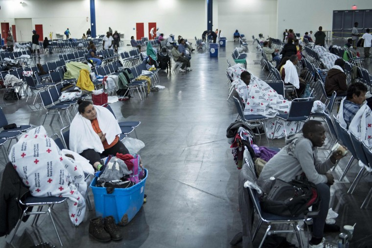 Flood victims rest at a shelter in the George R. Brown Convention Center during the aftermath of Hurricane Harvey on August 28, 2017 in Houston, Texas. (Brendan Smialowski/AFP/Getty Images)