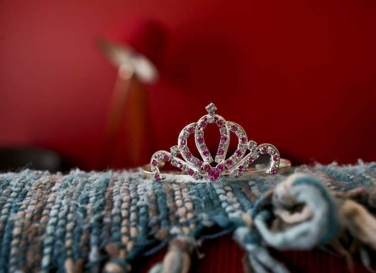 In this July 18, 2017 photo, a rhinestoned crown sits on a sofa in Luna's home in Santiago, Chile. Soon after Luna learned how to talk, she asked her mother why she had named her like a boy, if she wanted to be a girl. A judge ruled in favor of legally changing her name to match her chosen gender. (AP Photo/Esteban Felix)