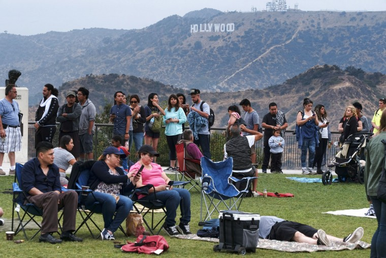 People wait in line to buy viewing glasses for the eclipse at the Griffith Observatory in Los Angeles early Monday, Aug. 21, 2017. (AP Photo/Richard Vogel)