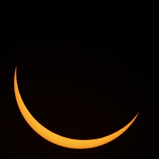 The moon passes in front of the sun during the partial phase of a total eclipse Monday, Aug. 21, 2017, as seen from a roadside park near Useful, Mo. (AP Photo/Charlie Riedel)
