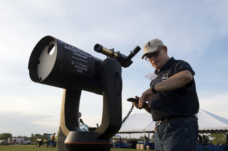 Beatrice resident David Knisely, with the Prairie Astronomy Club, sets his telescope to track the moon in preparation for the afternoon's total solar eclipse at the Heritage Center on Monday, Aug. 21, 2017, at Homestead National Monument of America in Beatrice, Neb. (Gwyneth Roberts/The Journal-Star via AP)