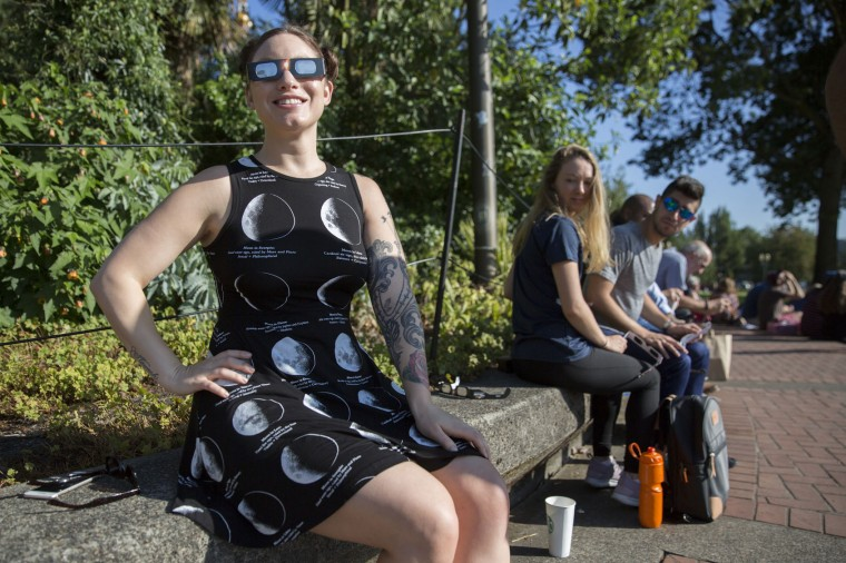 People gather on Monday, Aug. 21, 2017, at the Tom McCall Waterfront Park in Portland to catch a glimpse of the 2017 total solar eclipse. (Sarah Silbiger/The Oregonian/ via AP)