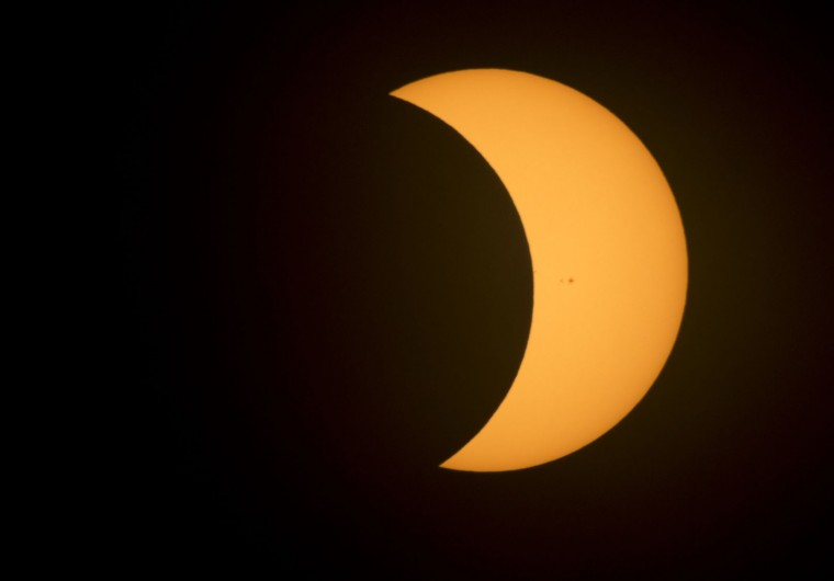 The moon covers a part of the sun during a partial eclipse in Richmond, Va., Monday, Aug. 21, 2017. (AP Photo/Steve Helber)