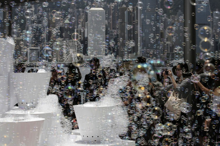 "An art installation ""Bubble Up"" created by Japanese artist Shinji Ohmaki produces bubbles in Hong Kong, Wednesday, Aug. 2, 2017. (AP Photo/Kin Cheung)"