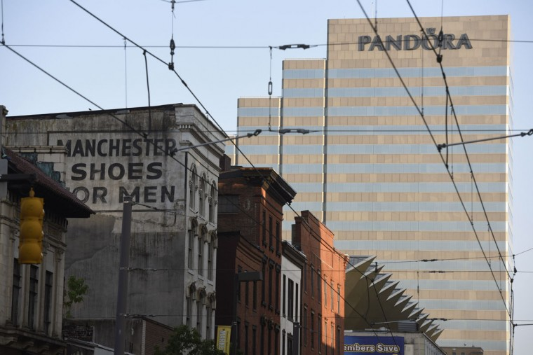 A Manchester Shoes For Men sign is easily seen on N. Howard St. (Kim Hairston/Baltimore Sun)